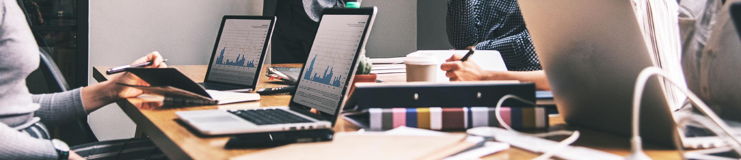 Working in Conference Room | Naples Global Advisors, SEC Registered Investment Advisor