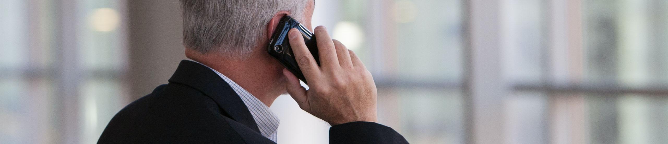 Man on Phone | Naples Global Advisors, SEC Registered Investment Advisor