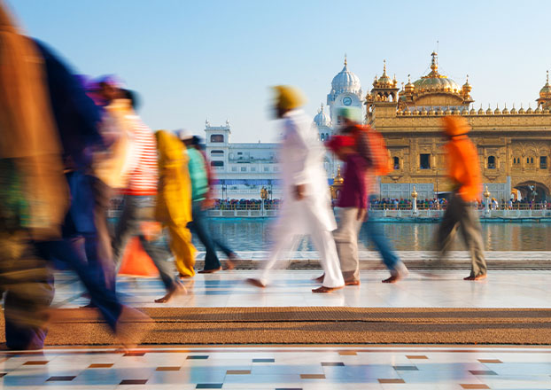 People Walking in India | Naples Global Advisors, SEC Registered Investment Advisor