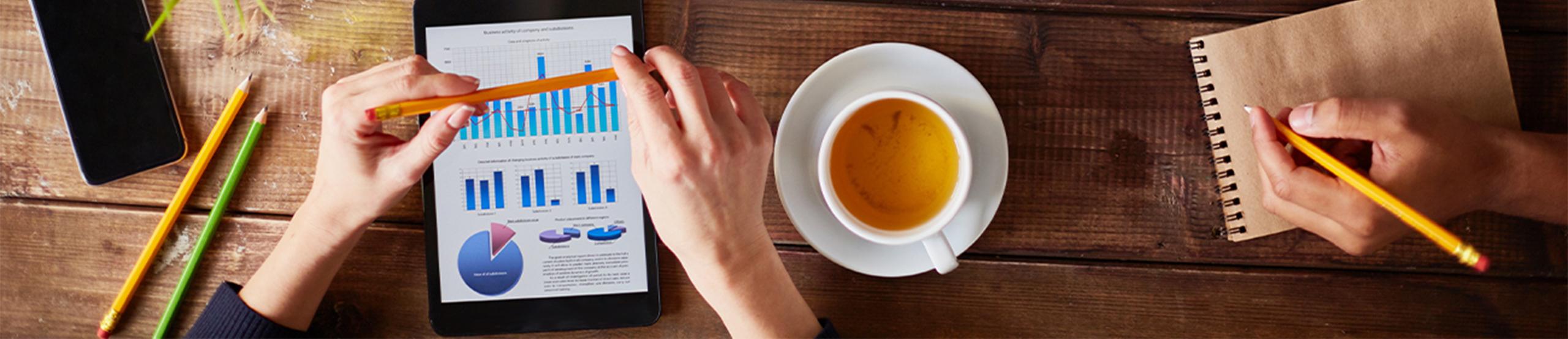Working on iPad | Naples Global Advisors, SEC Registered Investment Advisor