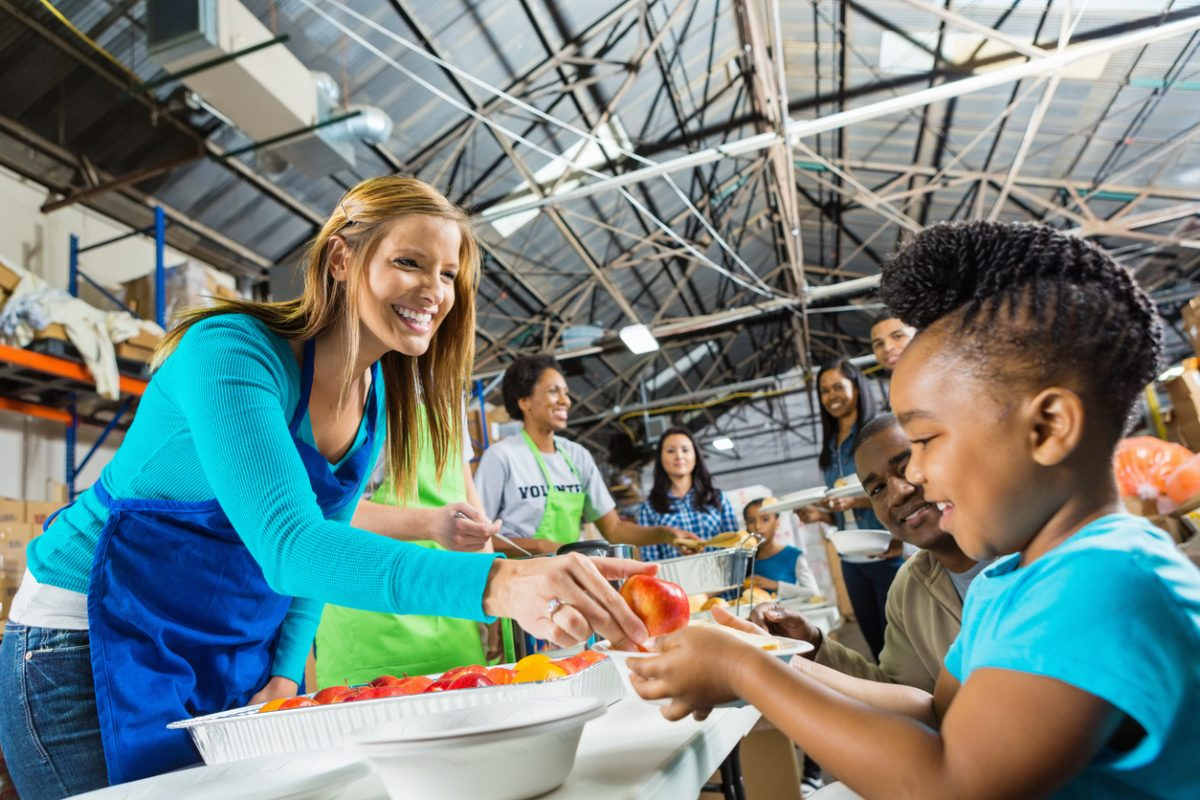 Volunteering at Food Kitchen | Naples Global Advisors, SEC Registered Investment Advisor