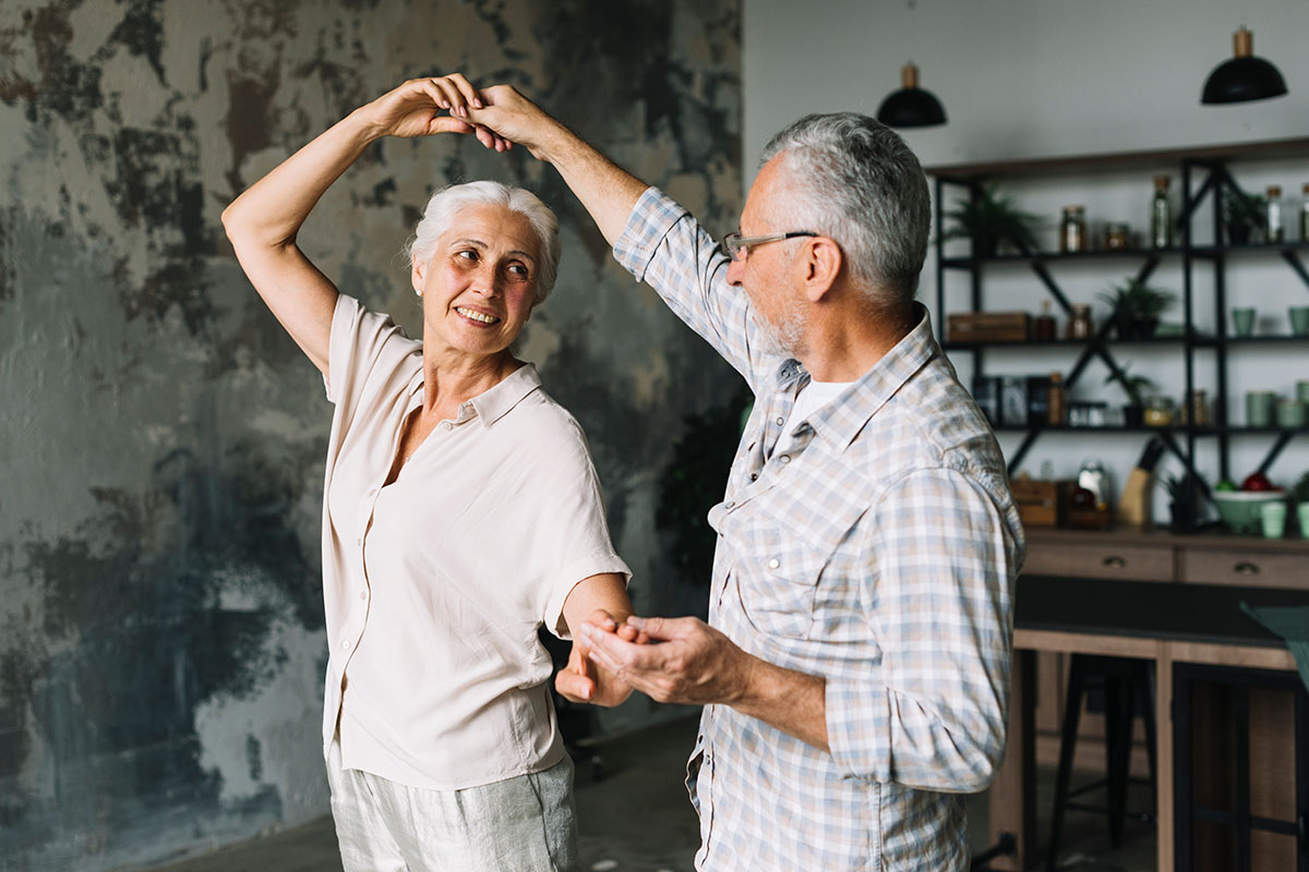 Retired Couple Dancing | Naples Global Advisors, SEC Registered Investment Advisor